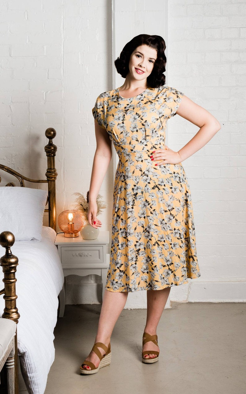 Vintage Style Dresses | Vintage Inspired Dresses 1940s vintage inspired teadress golden yellow with grey floral viscose Lady McElroy print. Made to order. $130.38 AT vintagedancer.com