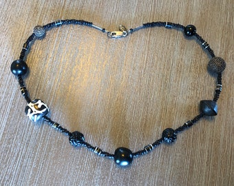 Multi cultural black themed trade bead necklace