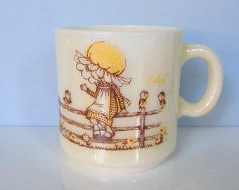 "Kirby Martin, Daisy Bonnet Girl Mug/ Holly Hobbie style girls with Birds on a fence, Yellow Milk Glass Coffee Mug, Cup/ 2 7/8"" W X 3 1/8"" H"