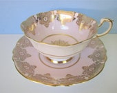 Paragon Fancy, Pink Gold Tea Cup, Saucer Gilded, filagree gold with medallion, footed teacup, saucer, S7977 Excellent