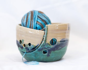 Knitting bowl with green, blue and creamy white glazes