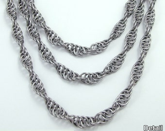 Layered and Simple Spiral Chain Necklaces in aluminum with saw-cut rings