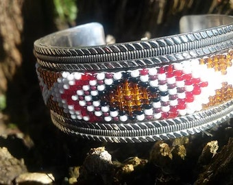 Beaded cuff bracelet set in sterling with black onyx accents
