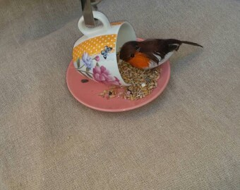 Unique handcrafted teacup and saucer bird feeder with cutlery hanger. Unique garden gifts.