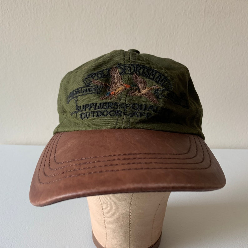 0dc2a89a1 Ralph Lauren Polo Sportsman Suppliers of Quality Outdoor Apparel Vintage  Hat Leather Bill 90s Ducks