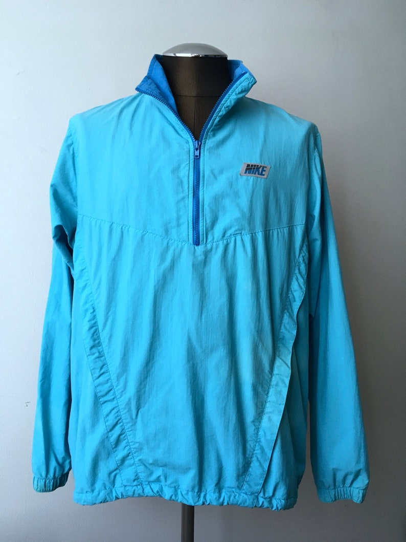 ba8cc9116e58 Nike Windbreaker Half Zip Sky Blue Athletics North Racing Team