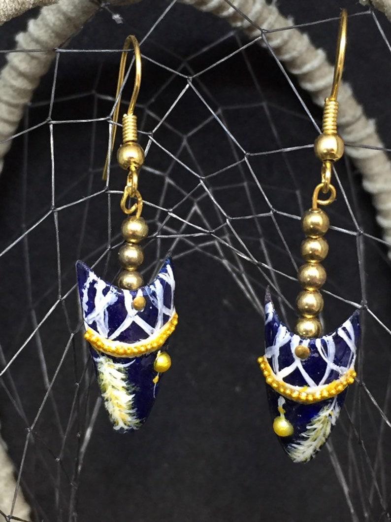 Capsule nails earring