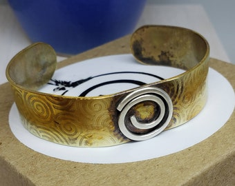 Celtic Inspired Hand Embossed Fire Treated Brass Cuff with Sterling Silver Spiral