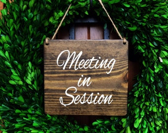 meeting in session sign