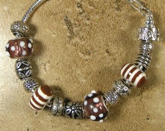 Bracelet of Brown and white European beads with silver spacers, adjustable closure - AB321