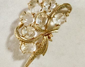 Vintage crystal brooch floral spray with clear oval stones in gold toned mounting