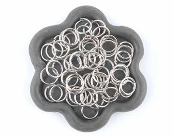 x 100 Silver jump rings 7mm (06th)