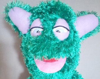 Professional, handmade hand puppet, monster, Muppet style, cross-eyed, supreme quality, unique, ooak, one of a kind