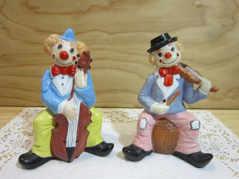 Set of Two Vintage Porcelain Clown Figurines Playing Music - Violin and  Cello