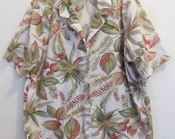 A Women's Vintage 80's Short Sleeve FLORAL Blouse By BOBBIE BROOKS.1X