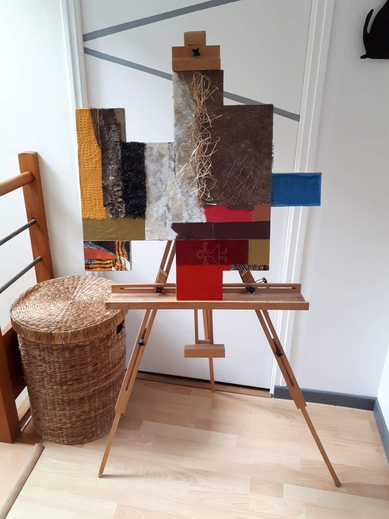 Collage of materials on wooden panel image 1