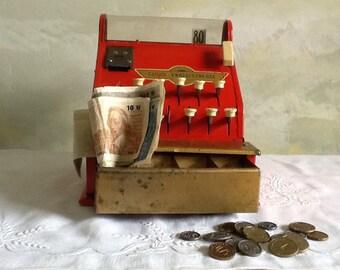 Vintage French toy cash register. Old toy cash register with toy french money. Red toy cash register.