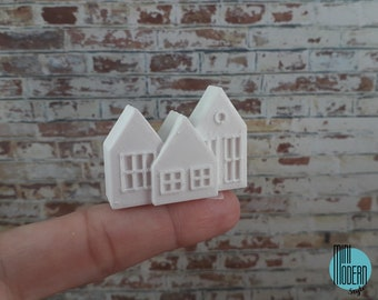 Coloured plastic Christmas cottage decoration in 1:12 scale for dollhouses