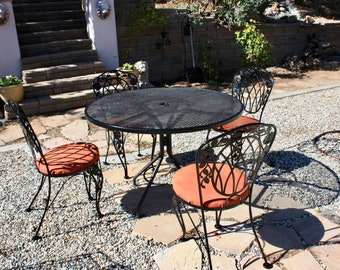 vintage wrought iron patio furniture circa 1950s table 4 chairs leaf patterns mesh table is 42 on diameter with center umbrella hole - Vintage Wrought Iron Patio Furniture