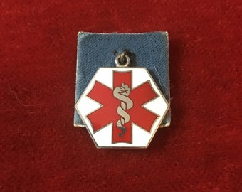 Wells sterling silver physician's enamel charm