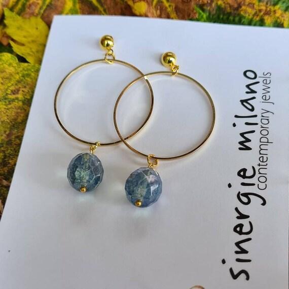 Gold hoop earrings, with blue crystal pearl. Pendant earrings.