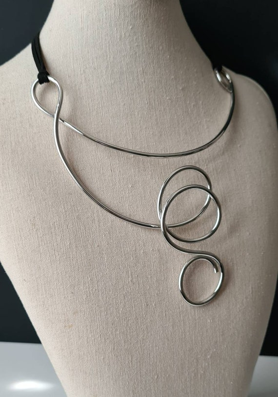 Artistic necklace, abstract drawing. Very bright! In German silver (alpacca) plated Titanium. It doesn't black out. Infinite light!