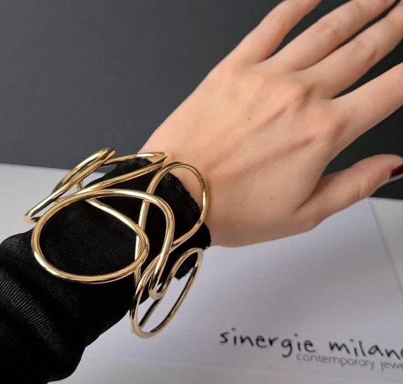 Large sculpture bracelet. Art to wear. Modern, contemporary, unconventional and elegant. Design SINERGIE MILANO