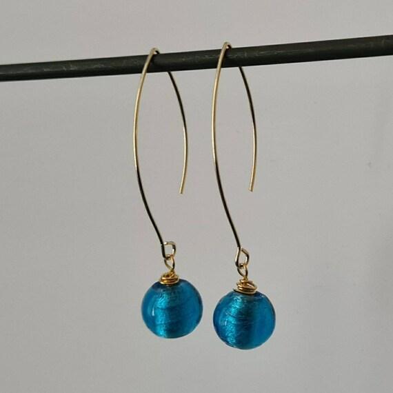 Hanging gold earrings, with beautiful blue Venetian glass pearl.