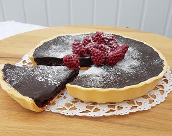 Fake Chocolate tart with raspberries, fake food