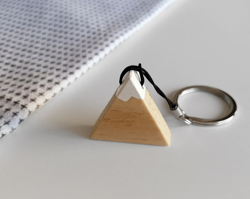 Snowy wooden mountain keychain. Perfect as a wedding image 0