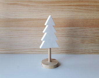 White wooden tree in Scandinavian style, ideal for a minimalist living room or a Nordic children's room. Great for Christmas