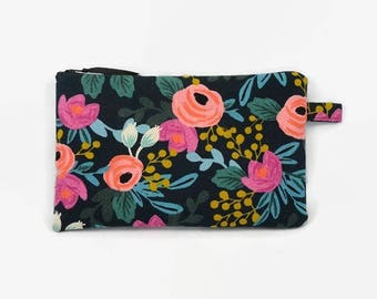 flat pouch in linen and cotton black background and flowers pattern