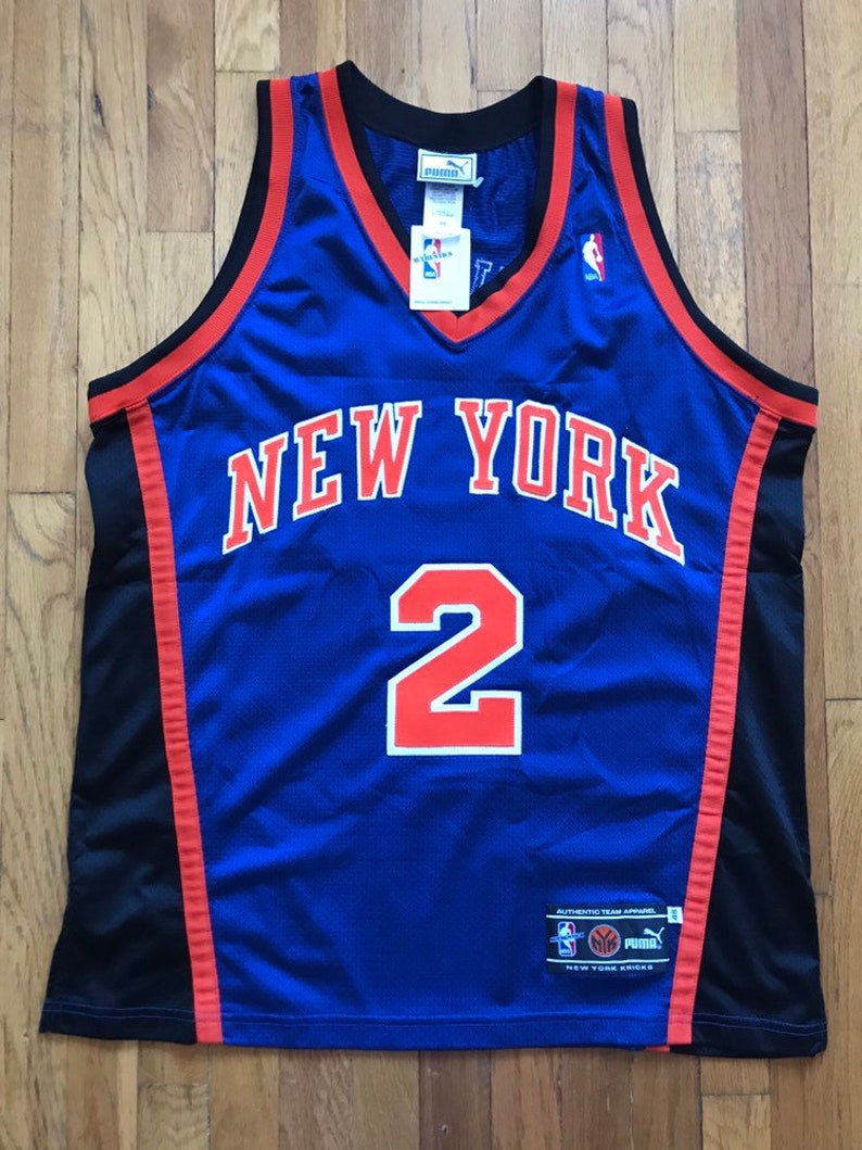 the latest 647b6 8d9f9 Vintage Knicks Larry Johnson Puma Jersey size 48 NWT