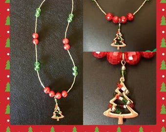 Beautiful red/green/gold beads with a Christmas tree pendant