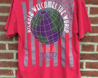 3f3967b9 Vintage Olympics shirt 1996 the Atlanta Olympic Games. Atlanta welcomes the  world.