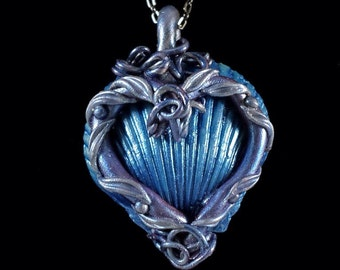 Scallop Shell Heart Pendant - deep blue pearl finish; blue, silver, rose heart resting on the shell. Embellished with blue leaves and vines
