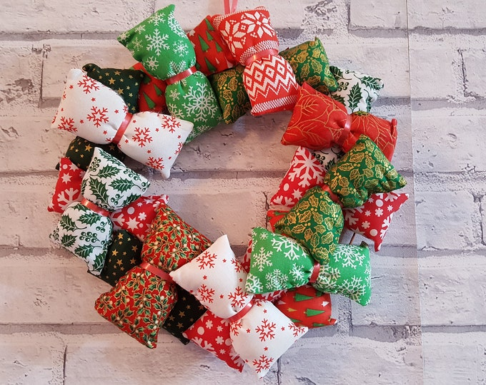 CHRISTMAS WREATH  made from assorted Christmas fabric in red, green and white