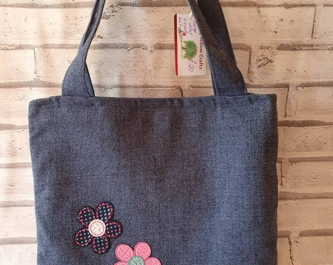 Tote bag handmade in blue woollen fabric with large zipped inner pocket.