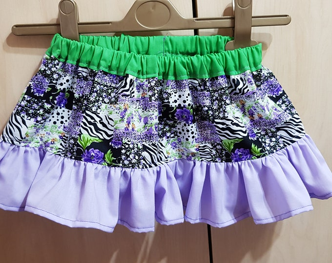 Girl's cotton skirt with elastic waist to fit age 9-12 months in mock patchwork style fabric