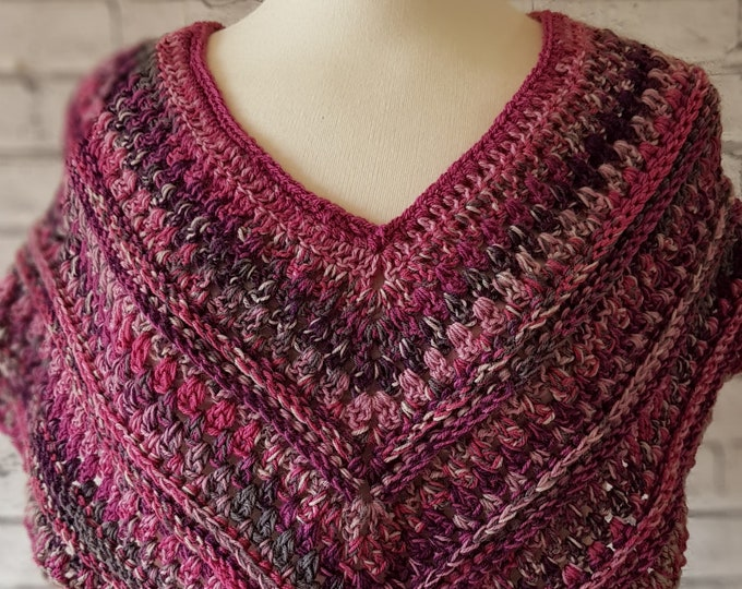 Ladies' crochet poncho style wrap in beautiful shades of deep pinks and purples.  Ideal as a cover up on cooler summer evenings.