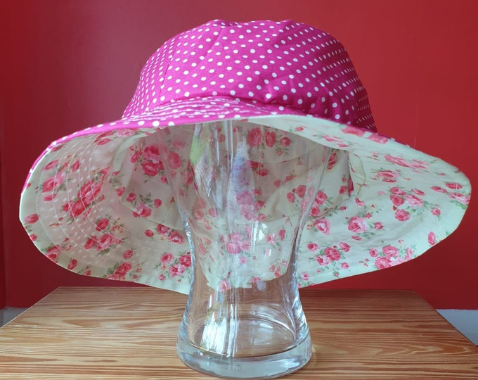 Ladies reversible sunhat in beautiful cotton fabrics, pink flowers on pale green one side and pink with white spots of the other