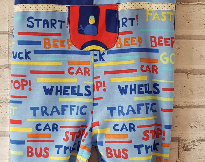 Baby dungarees, age 12-18 months,  bright car fabric, button shoulder fastening, inside leg poppers, easy changing