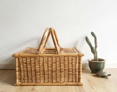 Wicker vintage picnic basket. Bohemian retro rattan basket with handle