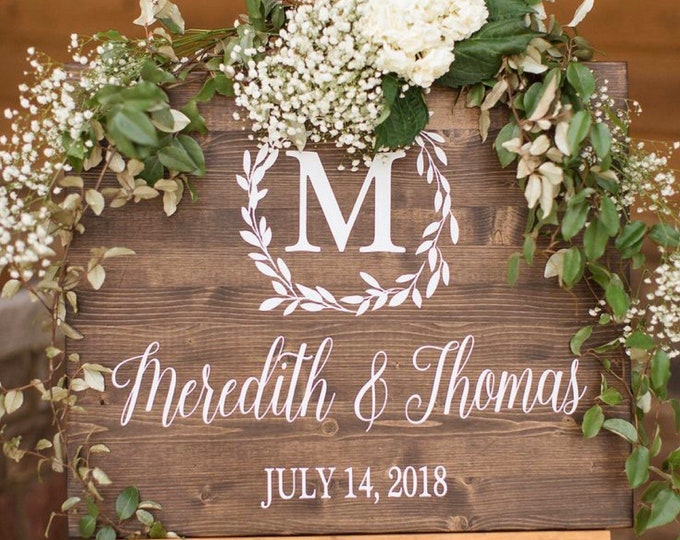 Featured listing image: Wedding Welcome Sign, Wedding Entrance Sign, Laurel Wreath Wedding Name and Date Sign, Rustic Wedding Decor, Wood Wedding Sign, Country Wedd