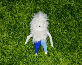 White Fuzzy Buddy With Blue Pants