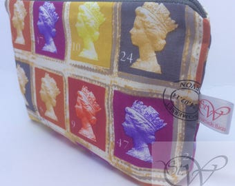 Colourful Stamps Small Make Up Bag with a Grey Zip and White Waterproof Lining.
