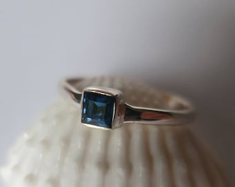 Genuine blue sapphire ring set in 92.5 sterling silver,0.33 carats, shipping included, link to purchase resizing below in item details