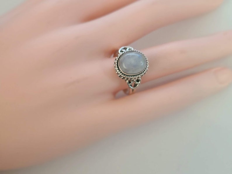 Genuine rainbow moonstone ring size 9.5 with option to resize set in 92.5 sterling silver