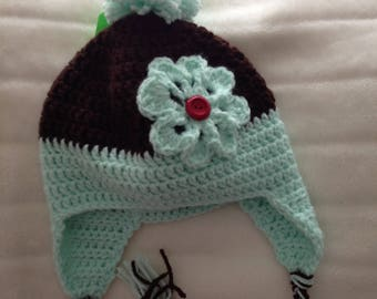 sweet girls flower earflap hat, big posy flower with button accent, mint and brown colours.has tassel and ties