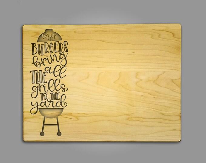 "Fun Etched Cutting Board ""burgers bring all the grills to the yard""- Cutting board.  9"" x 12"" x 3/4"" maple cutting board - Custom made"